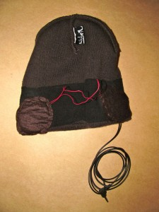 Stitch the headphones to the beanie